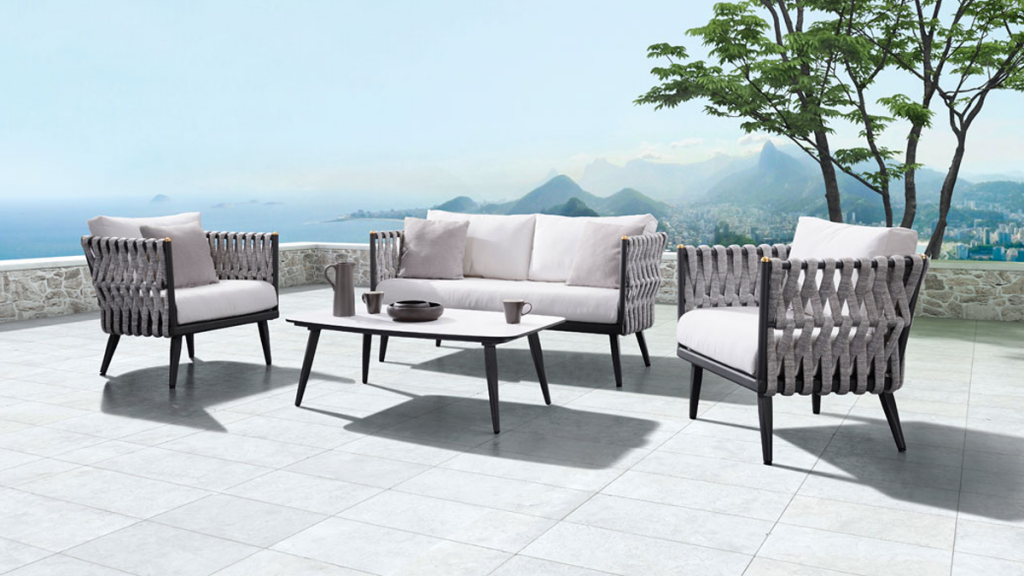 ON SALE NOW: Exclusive deep seating collection featuring matte black aluminum frames, tubular grey rope weave, and Sunbrella fabric cushions (limited availability).
