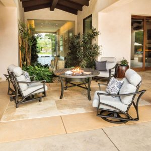 Tropitone club chairs and fire in a nice covered patio setting