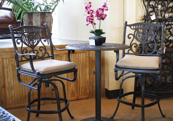 Traditional aluminum bar set - bar table and two bar height chairs.