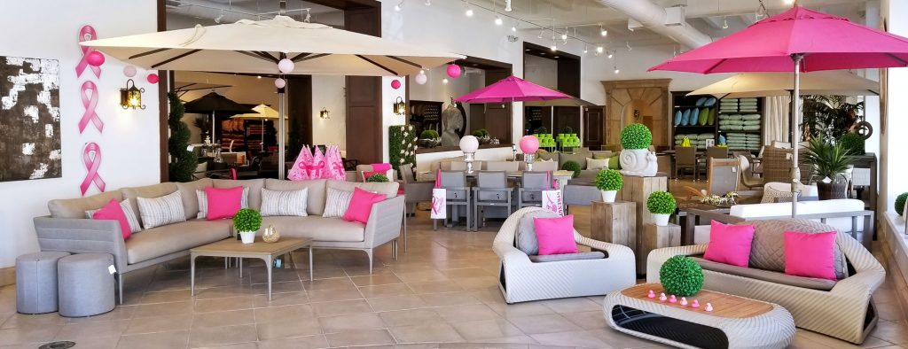 Patioworld showroom with pink decor for Breast Cancer Awareness Month