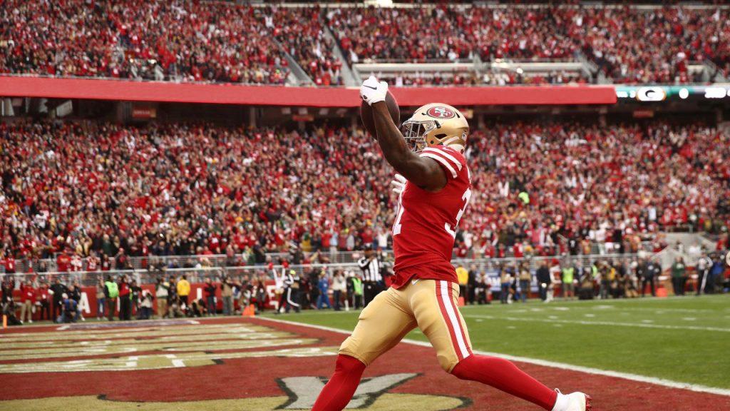 49er makes a touchdown on a football field